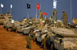 Tanques israelitas na fronteira de Gaza, antes da ofensiva terrestre. Foto de Amir Farshad Ebrahimi