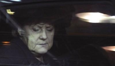 A cimeira adotou na íntegra a carta de Merkel e Sarkozy - Angela Merkel à chegada à cimeira europeia de dezembro de 2011