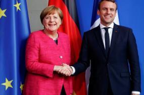 Angela Merkel e Emmanuel Macron. Foto: Simone Fontana/Flickr