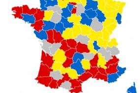 Resultados na primeira volta, por departamento: Amarelo – Emmanuel Macron, Cinzento – Marine Le Pen, Azul – François Fillon, Vermelho – Jean-Luc Mélenchon - Imagem da wikipedia