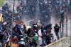 Guarda Nacional (da GNB) a atirar a matar sobre os manifestantes, a foto é da Reuters