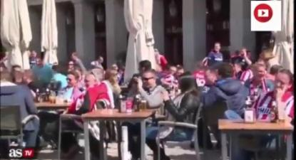 PSV Eindhoven fans throwing coins at beggars in Madrid