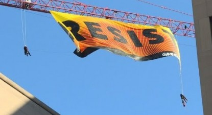 Greenpeace protesters climb crane near White House